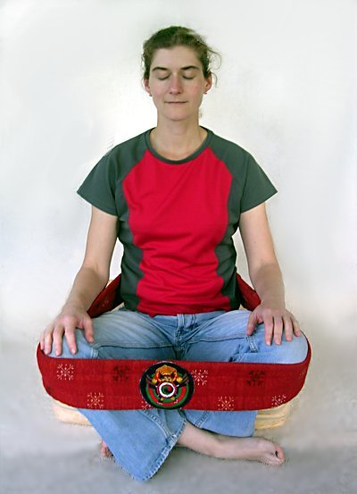 Sitting with a gomtag (meditation strap)
